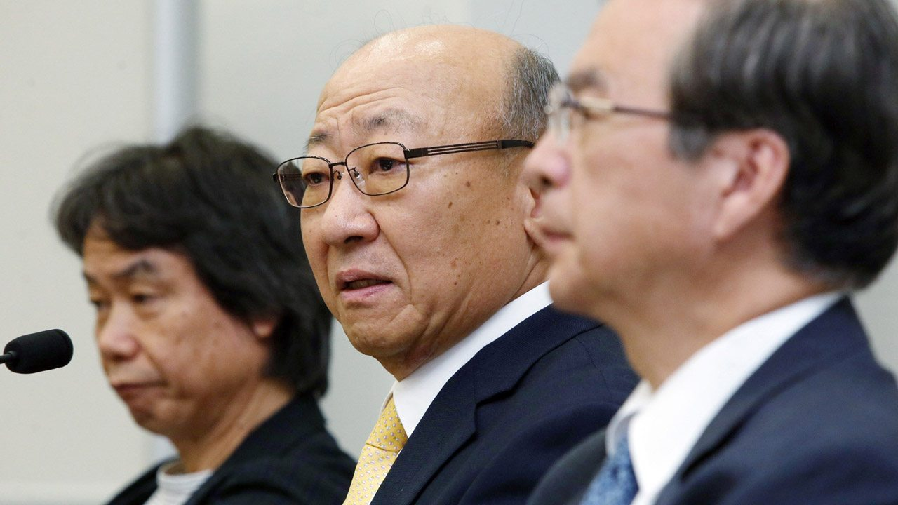 Tatsumi Kimishima(C), newly appointed president of Japanese videogame giant Nintendo speaks to reporters at the Osaka Stock Exchange in Osaka on September 14, 2015, while Nintendo's famous game creator Shigeru Miyamoto (L) looks on. Nintendo said it has appointed Kimishima as its new president two months after its chief executive Satoru Iwata died from cancer. AFP PHOTO / JIJI PRESS JAPAN OUT (Photo credit should read JIJI PRESS/AFP/Getty Images)